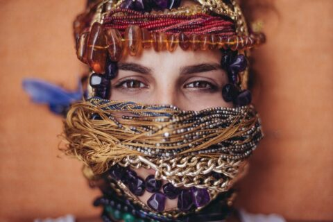 woman with jewelry wrapped around head