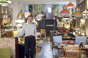 Portrait of a female business owner standing in her furniture store